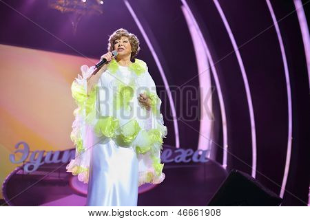 MOSCOW - OCTOBER 14: Singing Edyta Piecha in white at her anniversary concert in Kremlin Palace, on October 14, 2012 in Moscow, Russia. Famous Russian singer Edita Piecha is 75 years.