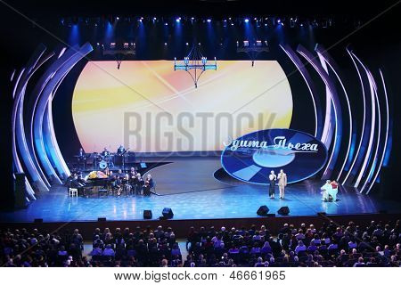 MOSCOW - OCT 14: I.Bronevitskaya, Y.Galtsev congratulate E.Piecha at concert of Edyta Piecha at Kremlin Palace, Oct 14 2012 Moscow Russia. Singer during lifetime became owner of large number of awards