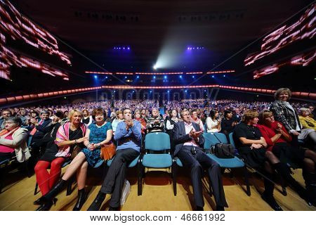 MOSCOW - OCTOBER 14: Audience claps at anniversary concert of Edyta Piecha in Kremlin Palace, on October 14, 2012 in Moscow, Russia.
