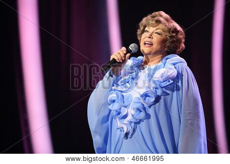 MOSCOW - OCTOBER 14: Edyta Piecha in blue dress sings at her anniversary concert in Kremlin Palace, on October 14, 2012 in Moscow, Russia. Famous Russian singer Edita Piecha is 75 years.