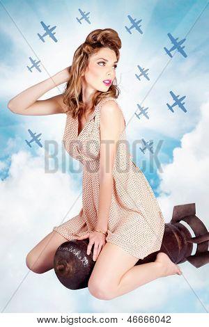 Classic Pinup Portrait. Female Beauty On War Bomb