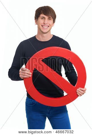 Happy Young Man Holding Prohibit Sign Over White Background