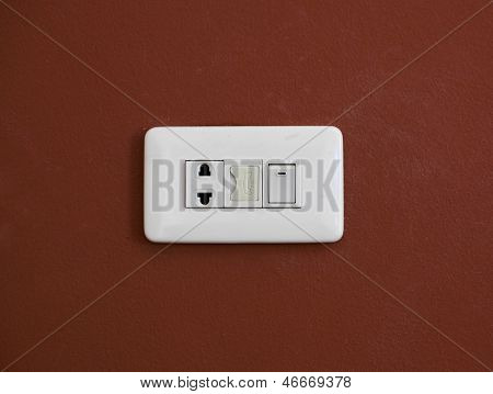 Power plug on white background brown