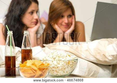 Young girls having slumber party and watching movies