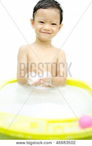 Little Boy Laughing In Washbowl