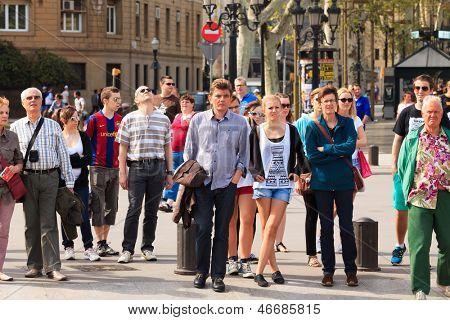 BARCELONA, SPAIN - APRIL 16: La Rambla on April 16, 2013 in Barcelona, Spain. Thousands of people walk daily by this popular pedestrian area 1.2 kilometer-long