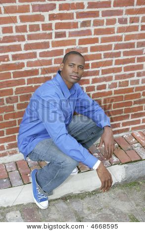 Guy Against Brick Wall