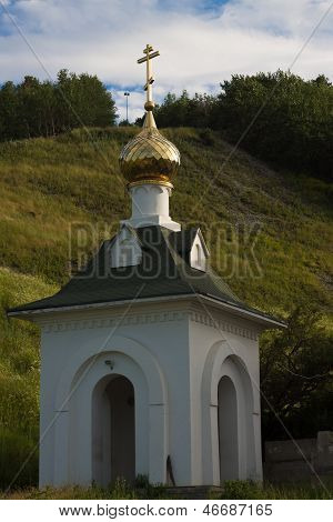 Gold dome of orthodox church with a cross
