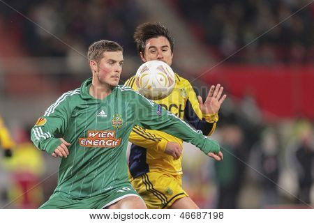 VIENNA, AUSTRIA - DECEMBER 6 Christopher Drazan (#19 Rapid) and Willian (#86 Metalist) fight for the ball on December 6, 2012 in Vienna, Austria.