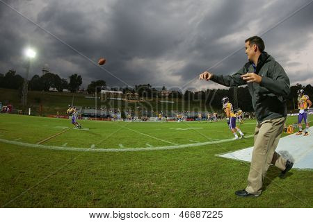 VIENNA, AUSTRIA - JULY 28 Head Coach Chris Calaycay passes the ball to LB Simon Blach (#49 Vikings) on July 28, 2012 in Vienna, Austria.