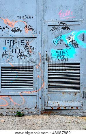 Dilapidated Old Metal Door To An Industrial Building