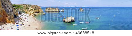 Panorama from the natural rocks and beaches at Lagos in the Algarve Portugal