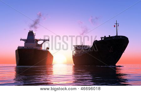 Two cargo ship at sunset.