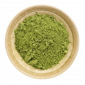 stock photo of moringa oleifera  - moringa leaf powder in a small ceramic bowl - JPG