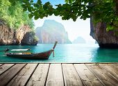 picture of sunny beach  - Adaman sea and wooden boat in Thailand - JPG