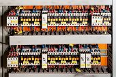 stock photo of fuse-box  - Image electrical panel with fuses and contactors - JPG