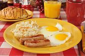 pic of hash  - Sausage and egg breakfast with hash browns and a chocolate filled croissant - JPG