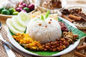 picture of ayam  - Nasi lemak traditional malaysian hot and spicy rice dish - JPG