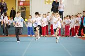 MOSCOW - DEC 1: Little boys run in stadium at children competition under auspices of MOSCOMSPORT in