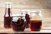 stock photo of cough syrup  - Jars with healthy freshly made dandelion syrup  - JPG