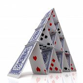 picture of collapse  - House of cards over a glossy white surface - JPG