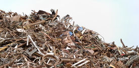 stock photo of scrap-iron  - stacked metal in scrap metal processing industry - JPG