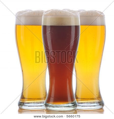 Glass Of Dark Ale And Two Pale Ales