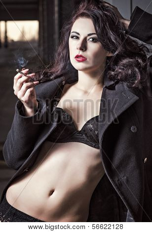 Closeup Portrait Of Sexy Smoking Vamp Woman In Underwear And Coat