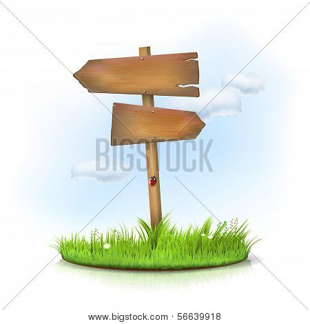 Wooden sign in the grass - crossroad