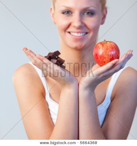 Blonde Woman Showing Chocolate And Apple Focus On Chocolate And Apple