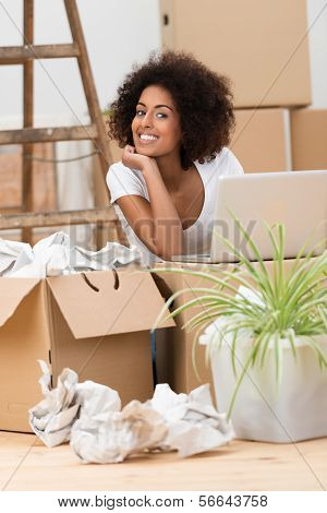 Woman Unpacking Boxes In Her New Home