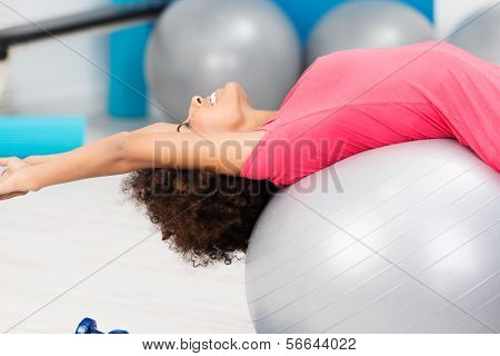 Happy Supple Woman Practising Pilates In A Gym