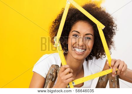 Excited African American Woman In Her New Home