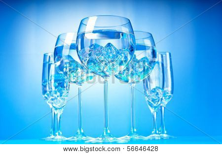 Water in the glass against gradient background