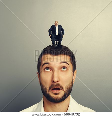 amazed man with small happy man on the head