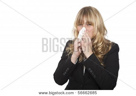 Businesswoman blowing her nose on a tissue