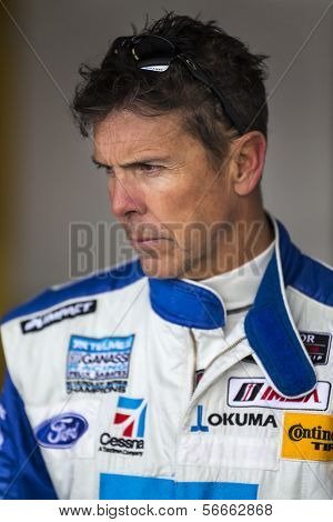 Daytona Beach, FL - Jan 03, 2014:  Scott Pruett watches his crew prepare his car before the Roar Before the Rolex 24 at Daytona International Speedway in Daytona Beach, FL.