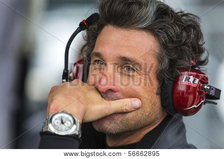 Daytona Beach, FL - Jan 04, 2014:  Driver, Patrick Dempsey, watches his crew work during the Roar Before the Rolex 24 at Daytona International Speedway in Daytona Beach, FL.