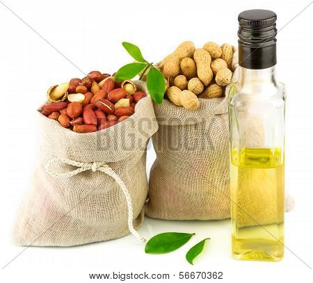 Sacks With Peanut And Glass Bottle Of Oil With Leaves
