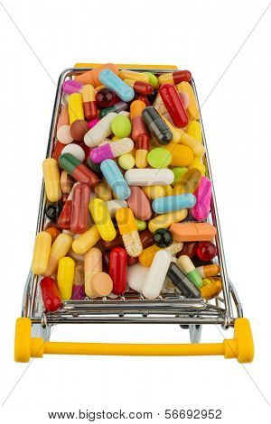 tablets with shopping cart. symbolic photo for the purchase of medicines on the internet