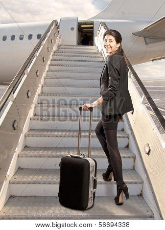 businesswoman looking back before boarding