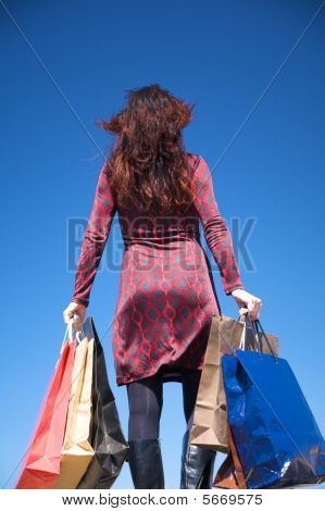 Back Woman With Shopping Bags