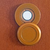 picture of peep hole  - a peephole on a brown wooden door - JPG