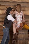 pic of western saddle  - A western couple is looking at each other and smiling - JPG