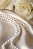 image of beads  - Pearl beads and cream rose on the silk background - JPG