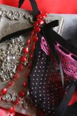 pic of g-string  - Valentines lingerie on a silver box with red heart beaded string - JPG