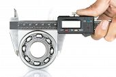 foto of ball bearing  - Metal vernier caliper and Ball bearings on white background - JPG