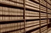 stock photo of academia  - A sepia image of shelves of old law books in a law library - JPG