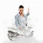 Image of businesswoman crushing with hand pile of keyboards