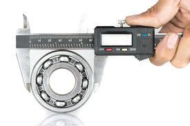image of vernier-caliper  - Metal vernier caliper and Ball bearings on white background - JPG
